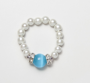 white beaded stretch ring with blue circular accent bead