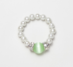 white beaded stretch ring with light green cat's eye circular accent bead