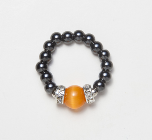 black beaded stretch ring with cat's eye orange accent bead