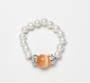 white beaded stretch ring with orange cat's eye circular accent bead