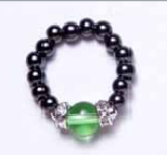 Black beaded stretch ring with Peridot ball accent