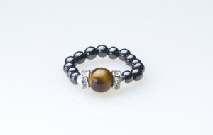 black beaded stretch ring with tiger eye accent bead