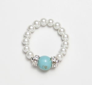 White beaded stretch ring with turquoise accent ball