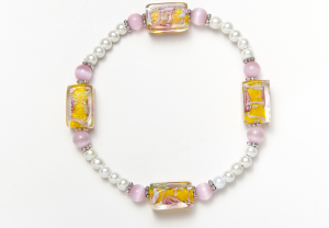 white magnets, pink cat's eye, and yellow and pink lampwork beaded bracelet