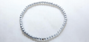 Thin White Magnetic Stretch Anklet with Silver Plated Ball