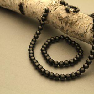 black magnetic ring, bracelet, and necklace set
